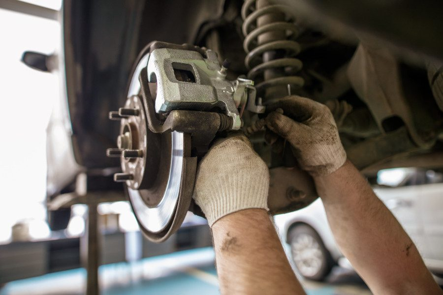 technician working on car breaks and suspension at CRS Automotive Hamilton